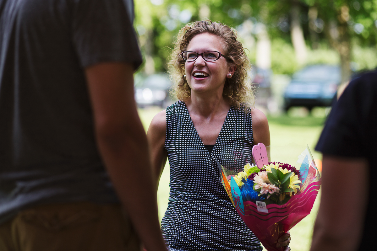 Employee holding flowers at the company picnic