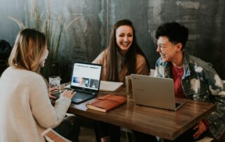 Employees Planning a Good Office Prank | myHR Partner