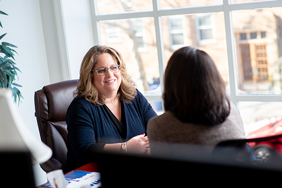 Tina Meeting With a Mid-size Organization Client in an Office